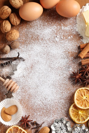 baking ingredients: Baking utensils, spices and food ingredients on wooden background with copy space.