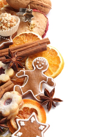 Dry orange and apple slices, spices and Christmas cookies on white background. Stock Photo - 20917786