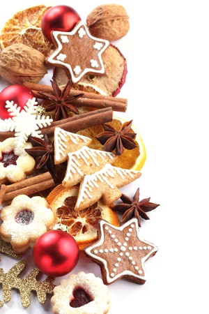 holiday cookies: Dry orange and apple slices, spices and Christmas cookies on white background.