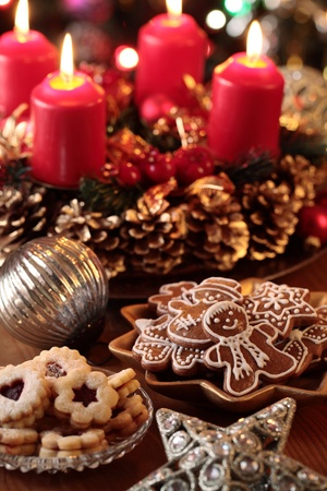 Christmas cookies and decorations on a table. Focus on girgerbread cookies photo