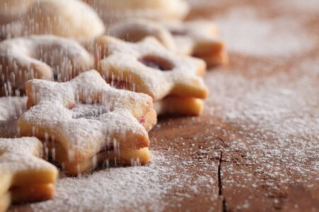 powdered sugar: Christmas cookies and pouring sugar- Selective focus and place for copy space.
