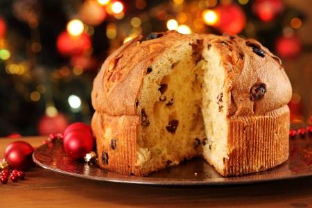 Christmas cake panettone and Christmas decorations. Stock Photo