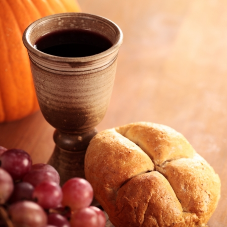 Bread, wine, grapes and pumpkin - thanksgiving or autumn still life photo