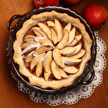 apple and cinnamon: Top view of apple pie in cake tin Stock Photo