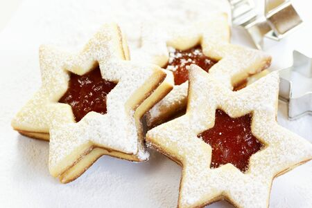 powdered sugar: Christmas cookies and cookie cutters on white background. Stock Photo