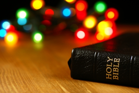 Holiday background with blurred lights and Bible