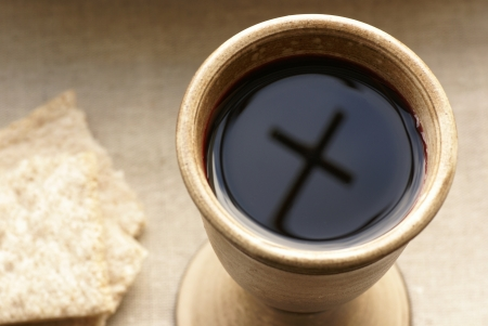 chalice bread: Chalice with wine and bread. Cross shadow in the chalice.