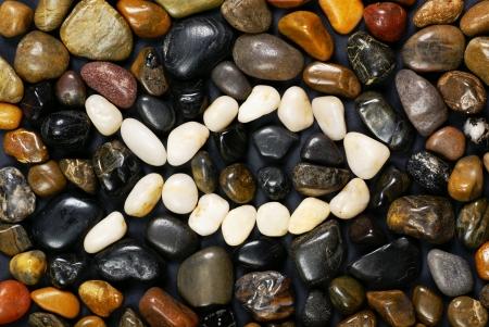 pez cristiano: Pescados - símbolo cristiano. Piedras blancas y oscuras Foto de archivo