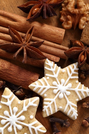 Gingerbread stars, spices and nut photo