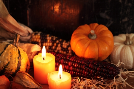 Arrangement of pumpkins, candles and autumn decorations 免版税图像