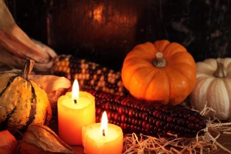Arrangement of pumpkins, candles and autumn decorations Stock Photo