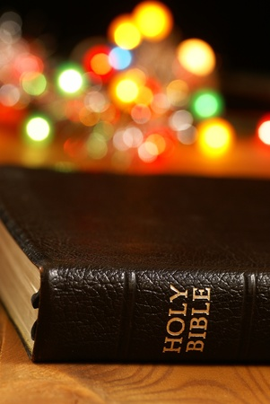 soul searching: Holiday background with blurred lights and Bible