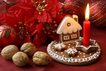 Gingerbread candlestick and Christmas decorations photo
