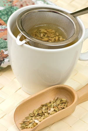 fennel seed: Fennel tee and seeds in a wooden spoon Stock Photo