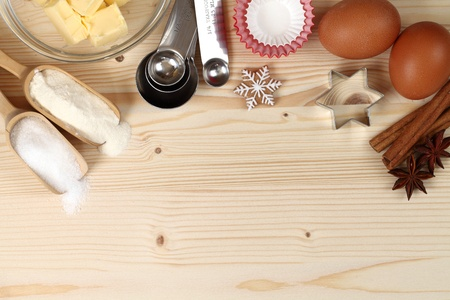 Baking utensils, flour, sugar, eggs,spices and butter with wooden copy space. Stock Photo - 21995018