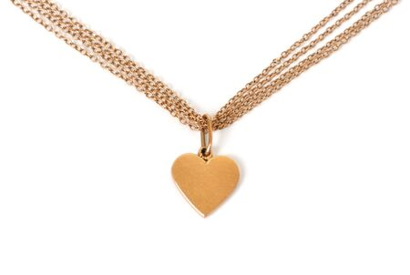 gold heart on chain, isolated on white Stock Photo - 6319681