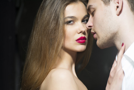 sexual relations: Glowing sexy couple standing close to each other, horizontal picture Stock Photo