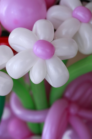 balloon bouquet: Beautiful bouquet of white and violet balloon flowers, vertical picture