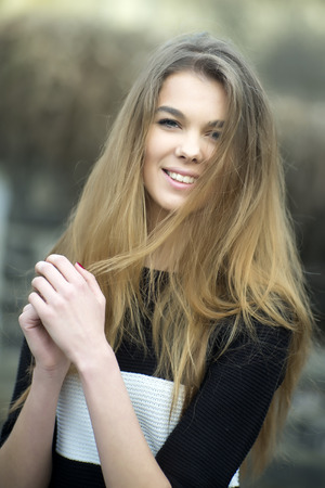 damsel: Portrait of a pretty young woman with long hair looking forward, vertical photo