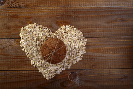 Oatcakes and heart shapes bunting on wooden table top copyspace, horizontal picture photo