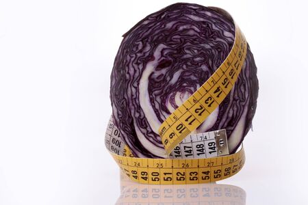 reflective: Red cabbage and measuring tape on a white reflective background