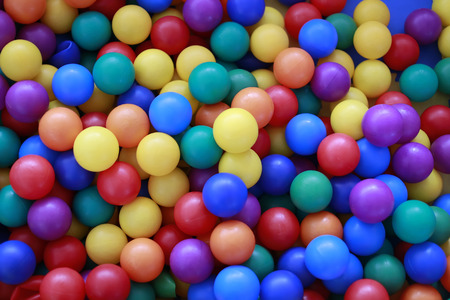 Bright colorful balls of blue red orange yellow green and violet colors background texture, horizontal photo Фото со стока