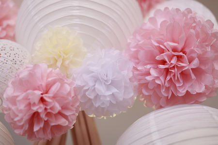 the trappings: White yellow and scarlet paper flowers and white chinese lantern, horizontal picture