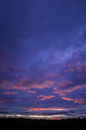 copyspase: Black city silhouette in dark blue purple sunset copyspase background, vertical picture