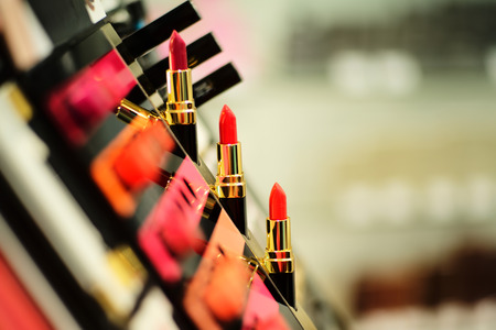 cosmetics collection: Cosmetic stand with a bright color palette of lipstick, horizontal picture Stock Photo