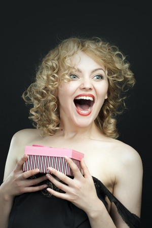 surprise: Excited young girl opening surprise gift box Stock Photo