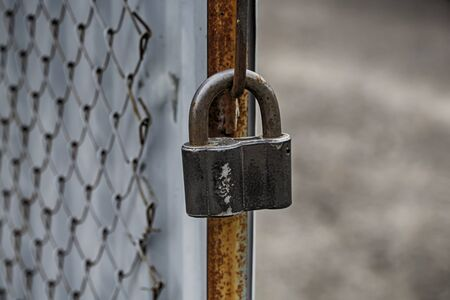 chain link fence: Chain link fence with black lock Stock Photo