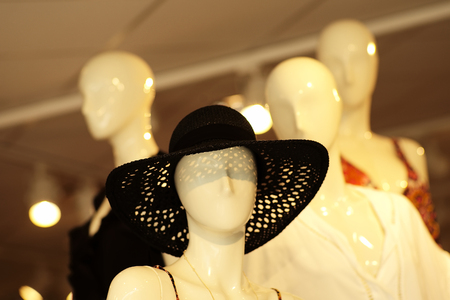 mannequin head: White plastic mannequin head in black summer hat indoor on shop background, horizontal picture Stock Photo