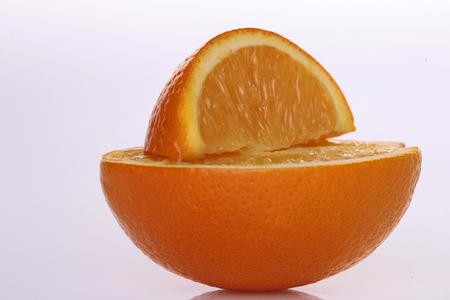 lobule: One round orange half with fresh juicy appetizing fruit lobule lying above in studio isolated on white background, horizontal picture