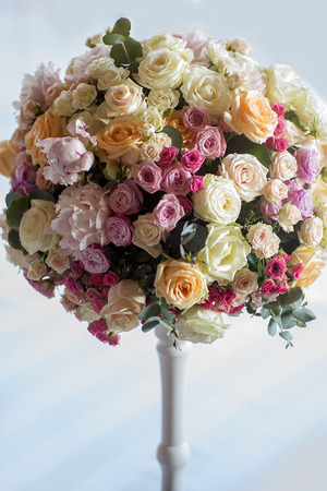 adorning: Adorning of wedding bouquet of fresh beautiful flowers of roses and peony white pink violet purple yellow lilac and orange colours in slim vase indoor, vertical picture Stock Photo