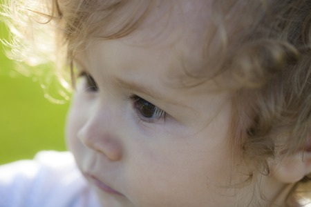 blond boy: Portrait of little cute blond boy with curly hair looking away outdoor closeup, horizontal picture