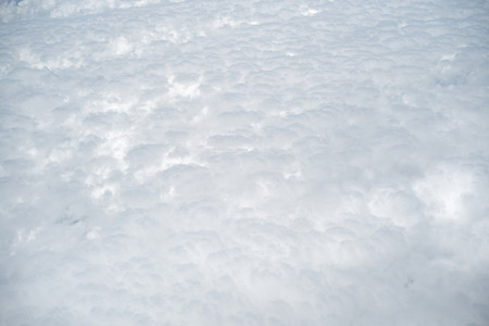 white clouds: Abstract wonderful outer view from flight of air hight space with grey sky and white fluffy rain clouds on natural background, horizontal picture Stock Photo