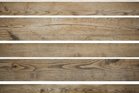 horizontal position: Few cutting wooden light brown colored empty building boards in horizontal position for signs or other advertisement text isolated on white background texture copyspace, Stock Photo