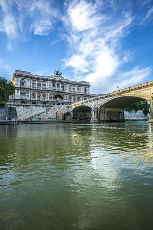 tevere: Beautiful view on historical landmark of Corte di Cassazione, Palace of justice, stone bridge through Tiberis or Tevere river in Italy, Rome, vertical picture