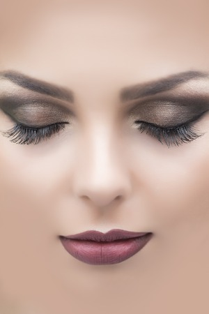 sensual: Closeup of beautiful attractive sensual female face with soft dark red or vinous lips brown closed eyes and long eyelashes of young sleeping beauty woman, vertical picture Stock Photo