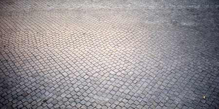 gravel roads: Top view on texture background of straight flat stony brick grey paving stone street road outdoor copyspace, horizontal picture Stock Photo