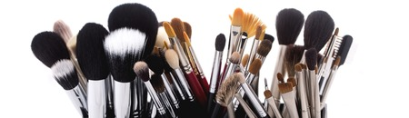 makeup a brush: Different professional natural soft make-up brushes for eyeshadow powder and facial foundation for visagistes black and brown colors on white background, horizontal picture Stock Photo