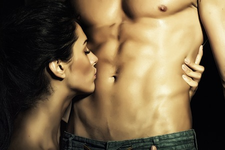 girl boobs: Closeup of undressed sensual pair of young brunette lady embracing and kissing man with beautiful muscular wet body with six-pack and abdoman, horizontal picture Stock Photo