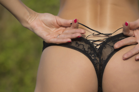 Closeup back view of female   in black lace   panties   Stock Photo