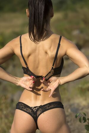 lace panties: Closeup back view of female   in black lace   panties   Stock Photo