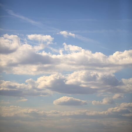 Natural color aerial overcast beautiful wallpaper background with bright blue open sky full of many small white clouds, square picture