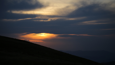 spaciousness: Beautiful spaciousness sunset landscape view from high hill top on cloudy grey blue yellow sky in dusk on natural evening background, horizontal picture