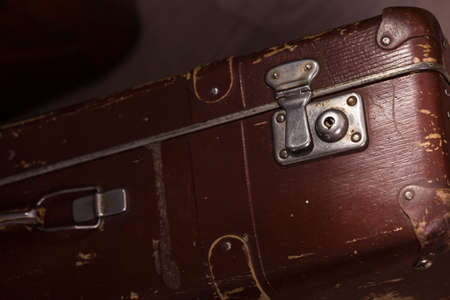 brown leather: Closeup of old fashioned aged brown leather brief case standing indoor in studio, horizontal picture