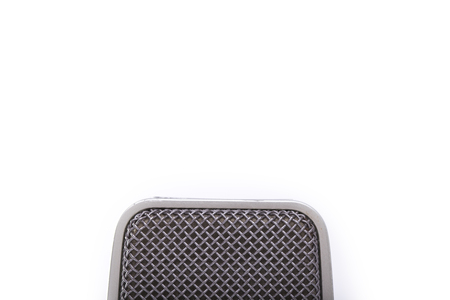 micro recording: Closeup view of one professional old fashioned aged microphone membrane grey color in studio isolated on white background, horizontal picture