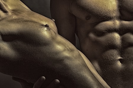 sex tenderness: Closeup of undressed sensual couple of man with beautiful muscular body and female nipple of young woman with bare chest near male six-pack standing close to each other, horizontal picture