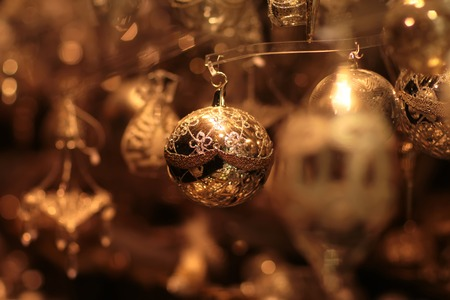 glitzy: Closeup view of many beautiful christmas or new year fir tree decoration of round colorful toy on blurred background, horizontal picture Stock Photo
